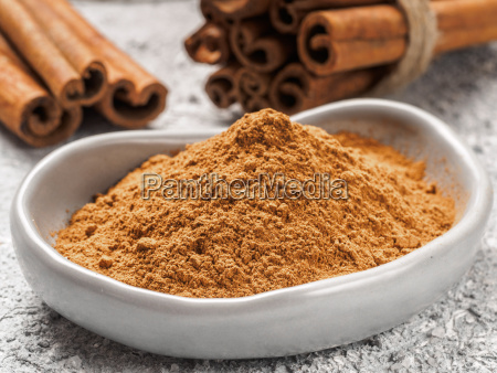 ground cinnamon on gray background
